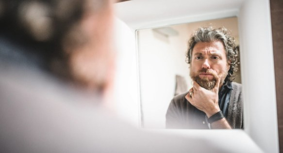 man-looking-in-the-mirror